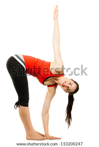 A happy healthy beautiful woman doing a yoga stretch. Isolated on white. - stock photo