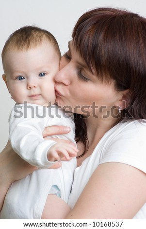 A happy holds her beautiful baby - stock photo