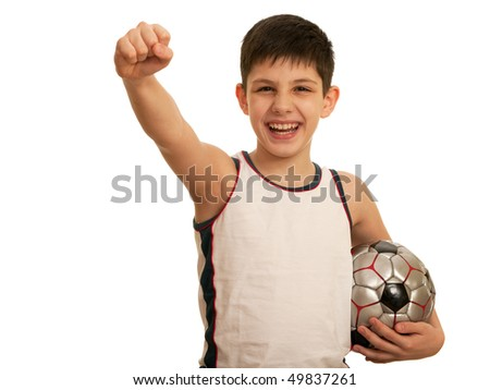 A happy kid is holding his right fist above his head; isolated on the white background - stock photo