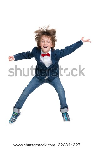 A happy little boy jumps on the white background - stock photo