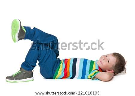 A happy little boy rests on the white background - stock photo