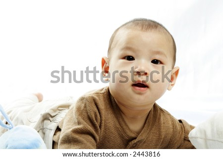 A happy little cute baby (isolated white) - stock photo