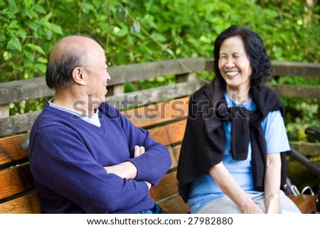 A happy mature asian couple having fun and laughing outdoor - stock photo