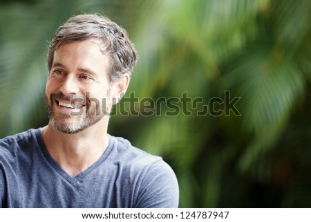 A happy mature man smiling - stock photo