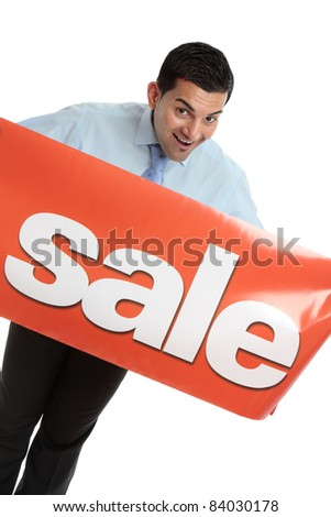 A happy salesman, businessman or other marketing person holding a vinyl sale banner.  White background. - stock photo