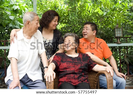 a happy senior couple and their children - stock photo