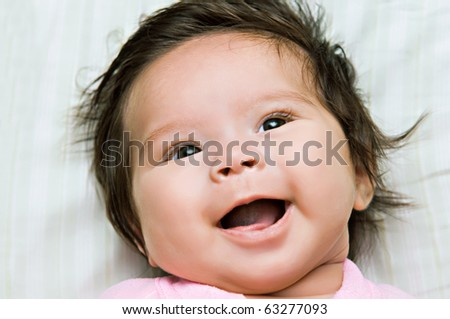 A happy smiling infant baby girl - stock photo
