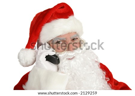 A happy, smiling santa claus on the telephone.  Isolated on white. - stock photo