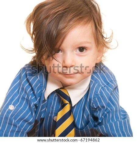 A happy smiling toddler in a shirt and tie; isolated on the white background - stock photo