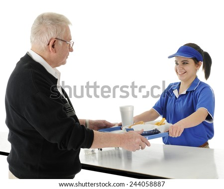 A happy teen worker happily serving a burger meal to a senior adult man.  On a white background. - stock photo