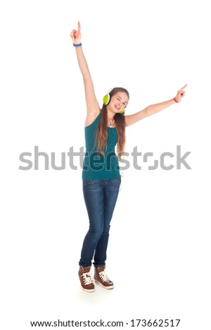 a happy teenager, listen to some music, on a white background - stock photo