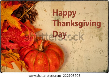 A Happy Thanksgiving card, with autumn decorations and text - stock photo
