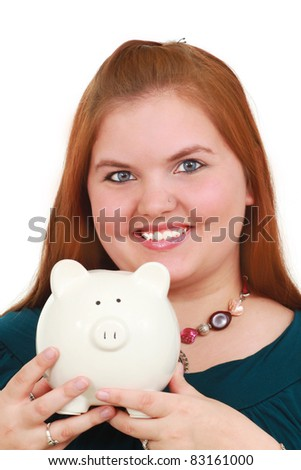 A happy woman holding a piggy bank - stock photo