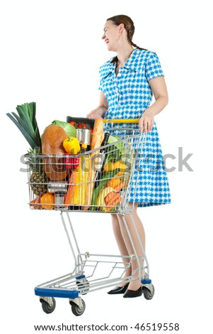 A happy woman with a shopping cart full of groceries on a white background - stock photo
