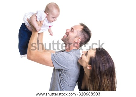 A Happy young couple holding a 3 months old baby  - stock photo