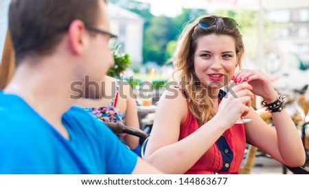 A happy young couple in a cafe. They are happy. - stock photo