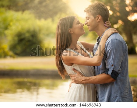 A happy young couple that is about to kiss. - stock photo