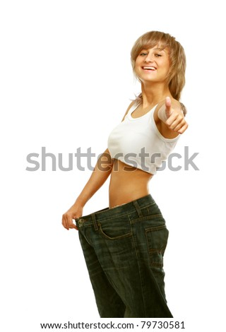 A happy young woman showing how much she lost, isolated on white - stock photo