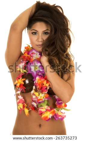 A Hawaiian woman with her flower lei, and coconut bra with a sensual expression on her face. - stock photo