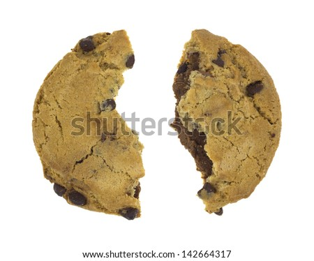 A hazelnut nougat filled chocolate chip cookie that has been broken in half on a white background. - stock photo