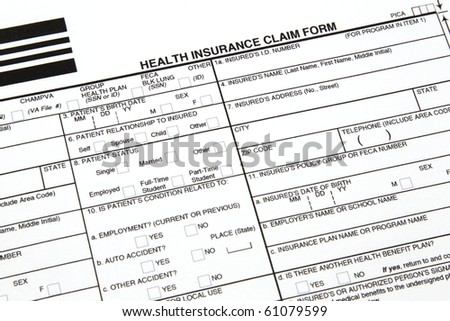 A health insurance claim form ready to be filled out for manual submission to an insurance carrier. - stock photo