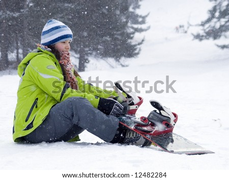 A  health lifestyle image of young adult  beautiful snowboarder girl (series sport, mountains, extreme, horses, teenagers) - stock photo
