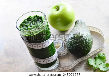 A healthy diet and detox. Smoothie with avocado, parsley, spinach and apples. - stock photo