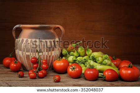 A healthy group of vegetables with a pot on a table - stock photo