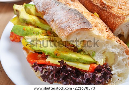 A healthy vegetable sandwich with avocado, tomatoes and cheese - stock photo