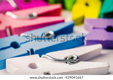 a heap of color wooden clothespins - stock photo