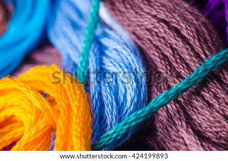 a heap of colorful threads macro - stock photo