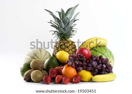A heap of colorful tropical fruits - stock photo