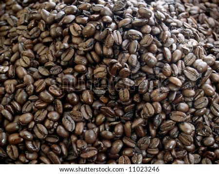 A heap of dark roast coffee beans - stock photo