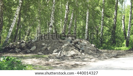 A heap of earth and stones - stock photo