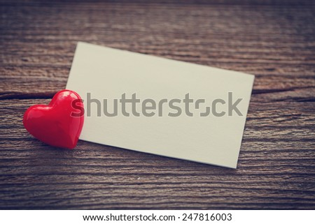 a heart and a empty memo on wooden board for valentines day - stock photo