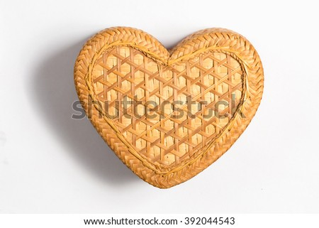 a heart-shaped bamboo box isolated on a white background, handicraft from Thailand.  - stock photo