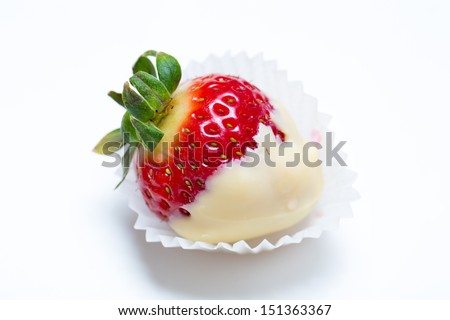 a heart shaped strawberry dipped in chocolate fondue, valentine's day - stock photo