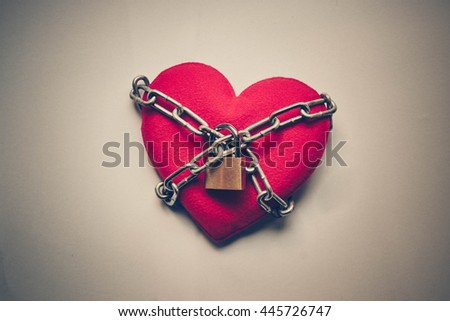 A heart tied with chains and locks - stock photo