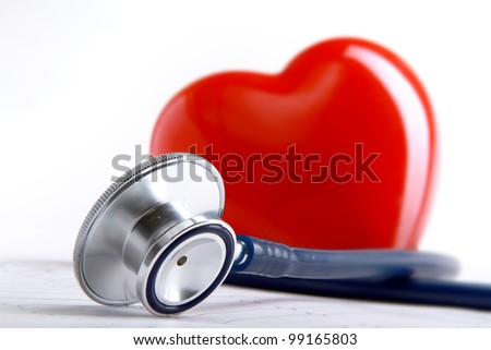 A heart with a stethoscope lying - stock photo