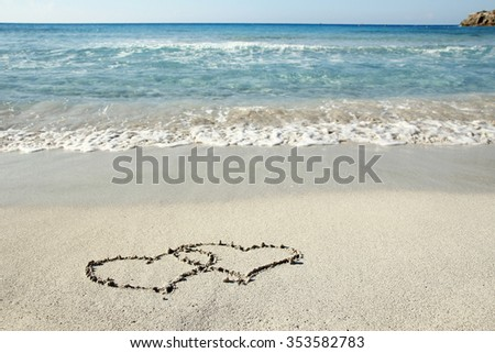 a hearts in the sand on the beach - stock photo