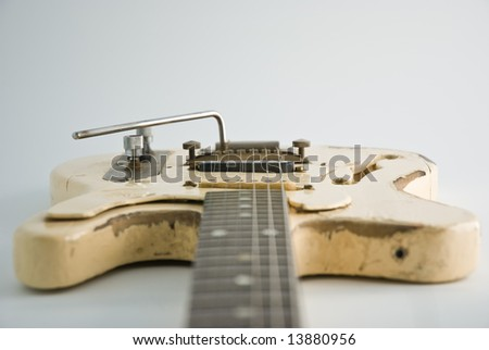 A heavily used electric guitar. Focus on black pickup. - stock photo