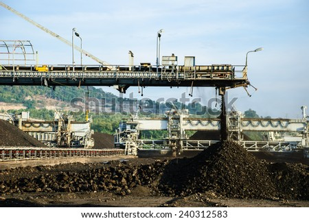 A heavy machine is called 'Staker', operates in coal stock pile, Mae Moh mine, Lampang, Thailand. - stock photo