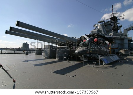 A helicopter on a deck of a battleship - stock photo