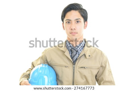 A helmeted man - stock photo