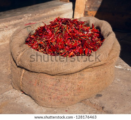 A hessian sack of dried red chillis - stock photo