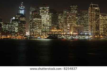 A high-resolution stitched image of San Francisco downtown in Christmas lighting at dusk (shot from Treasure Island). Copyspace at bottom. This lighting can be seen for 1.5 months in a year. - stock photo