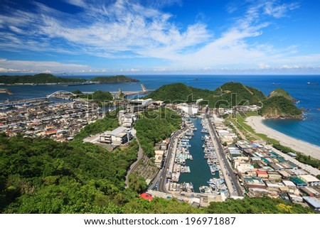 A high view from the sky of a small town beside the ocean. - stock photo