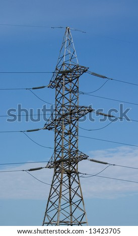 A high voltage cabling line over a blue sky - stock photo