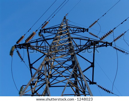 A high voltage power line - stock photo