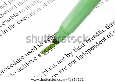 A highlighter is being used to highlighting important words - stock photo
